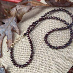 Garnet gemstone and gold filled strand necklace